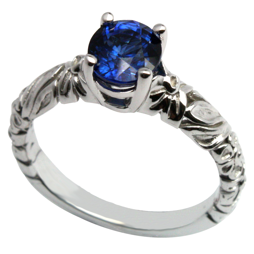 Deep Blue Sapphire in White Gold Floral Mounting